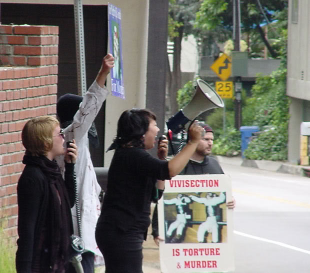 Picketers demonstrating in the street in front of a researcher's home.